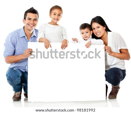 Family holding a banner and smiling - isolated over a white background