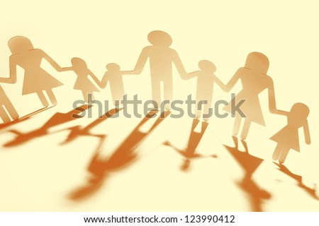 Family holding hands, casting shadows - stock photo