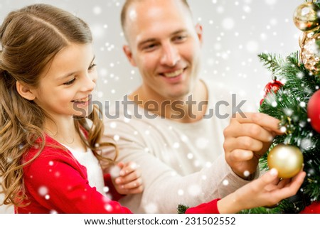 People Decorating decorating tree stock photos, royalty-free images & vectors