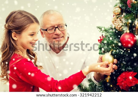 People Decorating A Christmas Tree family decorating tree stock images, royalty-free images & vectors