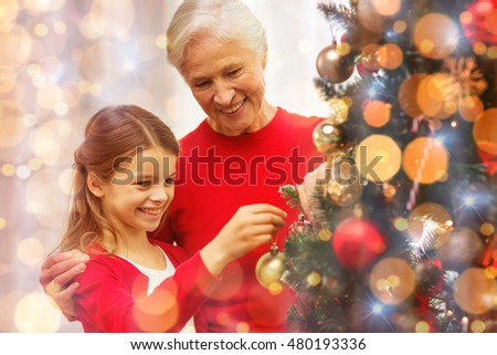 People Decorating A Christmas Tree young decorating family room stock fotos, billeder til fri