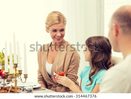 family, holidays, thanksgiving, generation and people concept - smiling family having dinner at home