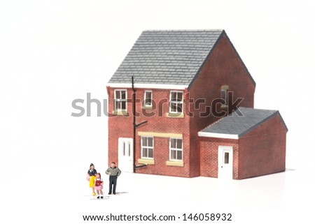 Family home concept with model house and people on white background