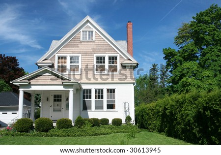 Family house in a green setting, suburban neighborhood setting