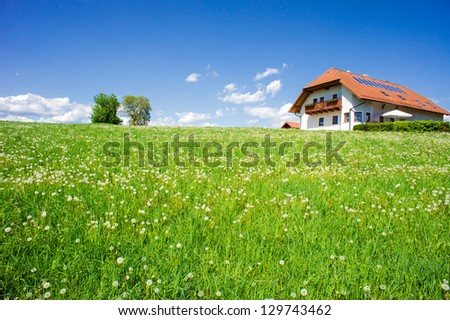 Family house in a summer landscape, taken in upper austria - stock photo
