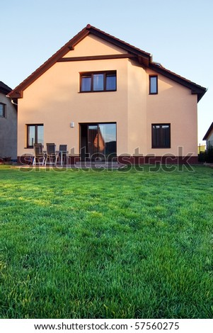 Family house with a lawn at dawn - stock photo