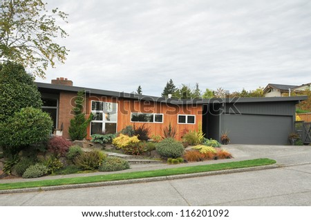 Family house with short driveway and landscaping - stock photo