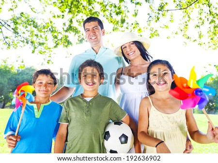 Family in a park. - stock photo