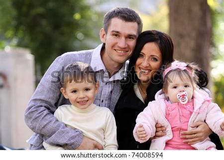 family in autumn park - stock photo