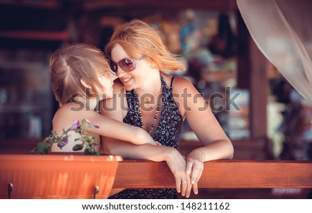 family in cafe at sea - stock photo