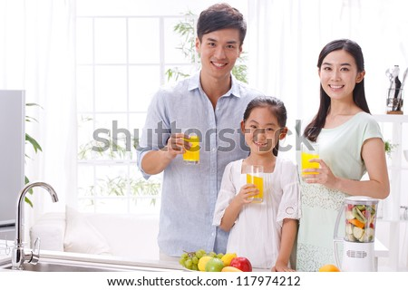 family in kitchen - stock photo