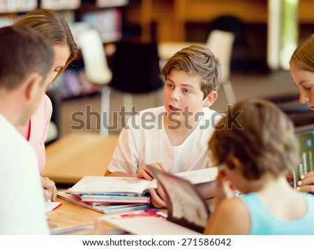 Family in library with books - stock photo