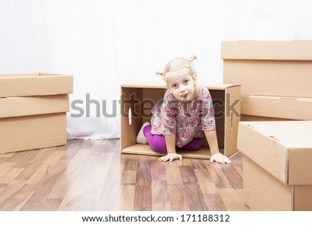 family in move, little girl in box - stock photo