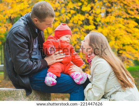 family in park in autumn