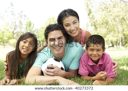Family In Park With Football - stock photo