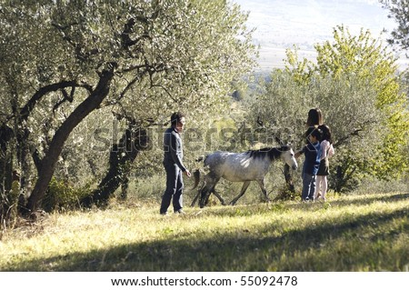 family in the country with horse - stock photo