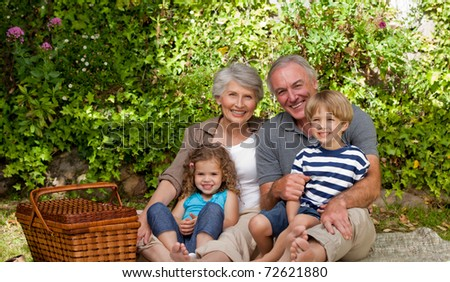 Family in the garden - stock photo