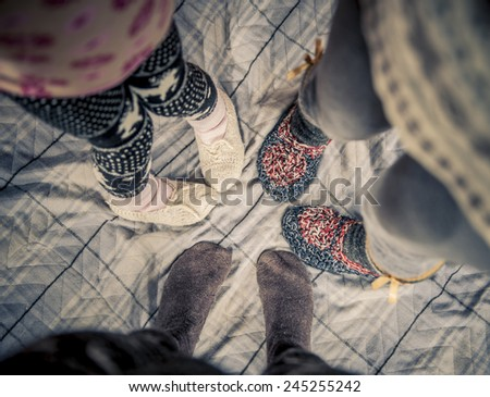 Family in wonderful stockings, feet close-up. - stock photo