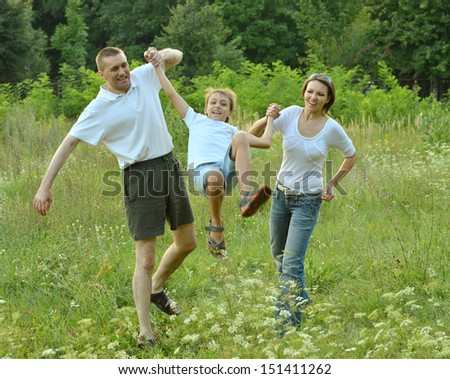 Family is having fun in a green summer park