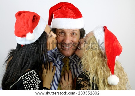 Family kissing on Christmas Day