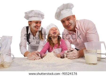 Family kneading dough together isolated on white. - stock photo
