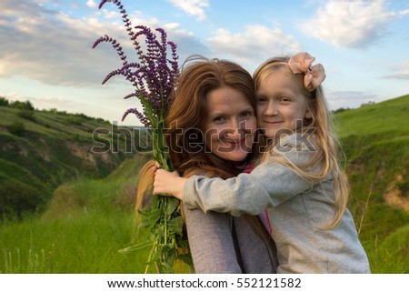 family. Laughing mother with daughter outdoors