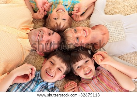 Family laying in a circle - stock photo
