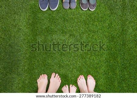 Family legs  standing  opposite shoes  - stock photo