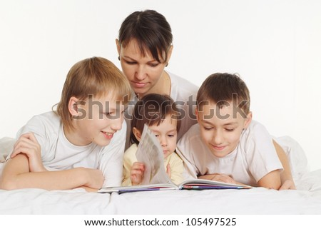 family lie on the floor and writing