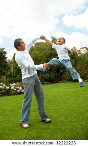 family lifestyle portrait of a dad with his son having fun outdoors - stock photo