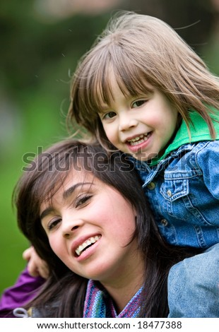 family lifestyle portrait of a mother with her son having fun outdoors - stock photo