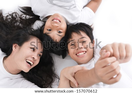 family lifestyle portrait of a mum and dad with their two kids having fun - stock photo