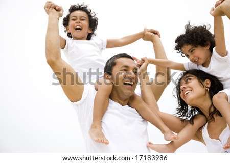Family lifestyle portrait of a mum and dad with their two kids having fun