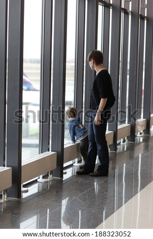 Family looking at aircraft in the airport