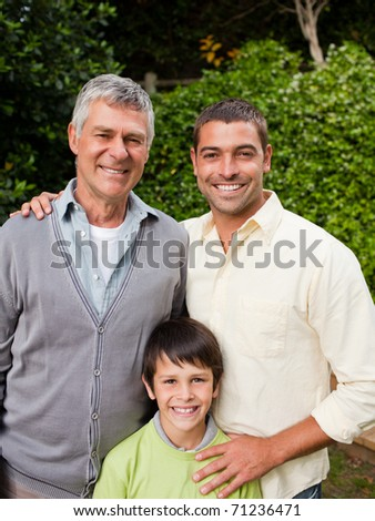 Family looking at the camera - stock photo