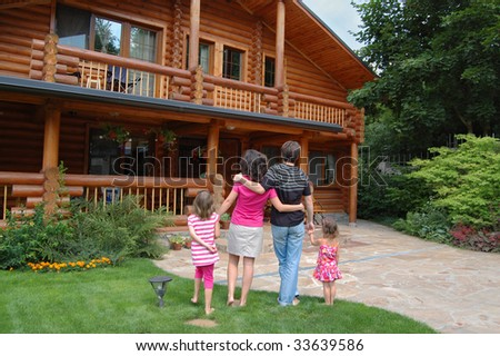 Family looking at the house - stock photo