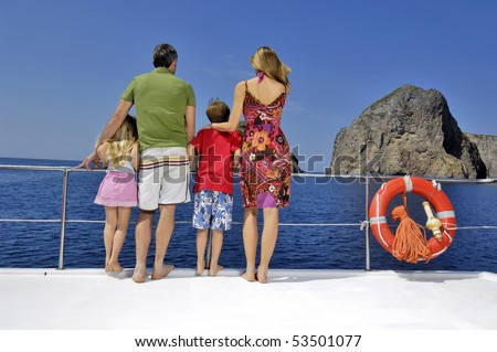 Family looking outside from a boat - stock photo