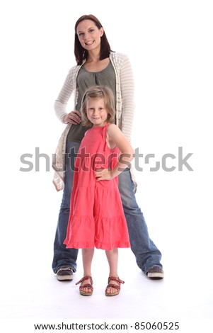 Family love of mother and daughter having fun posing together in studio. Girl is six years old wearing coral red dress while mother wearing blue jeans and long cardigan.