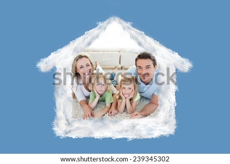 Family lying on the carpet against blue background with vignette - stock photo