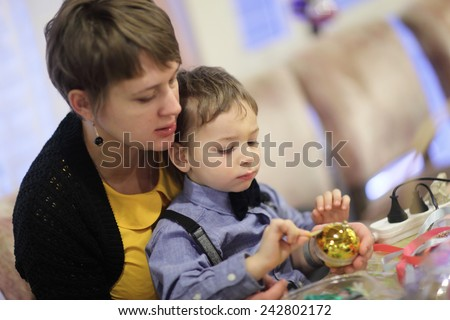 Family making Christmas decorations in the classroom - stock photo