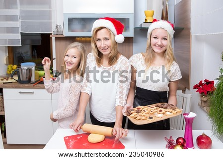 family making xmas cookies at home