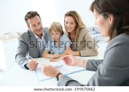 Family meeting real-estate agent to buy new home - stock photo