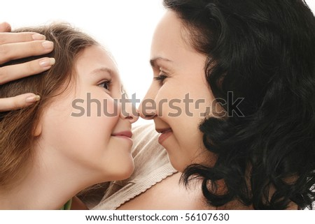 family. Mother and daughter embraces. Two happy smiling female, adult and young. - stock photo