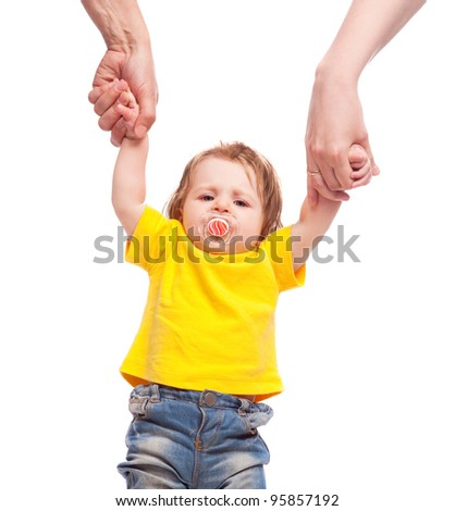 family; mother and father holding their displeased daughter by the hands, isolated against white background - stock photo
