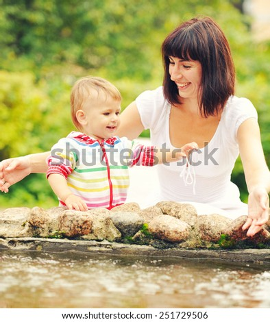 Family mother with child happy outdoors - stock photo