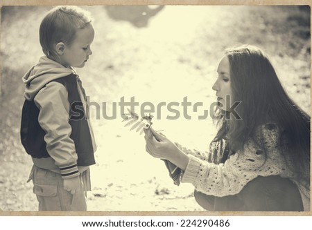 family mother with child son in park are playing