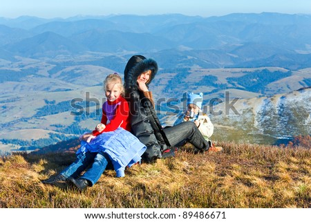 Family (mother with children) walk on autumn  mountain plateau. - stock photo