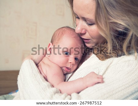 Family mother with newborn baby infant child home - stock photo