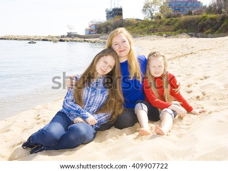 Family mother with two daughters on beach, recorded in Saint Constantine and Helen resort, Bulgaria.