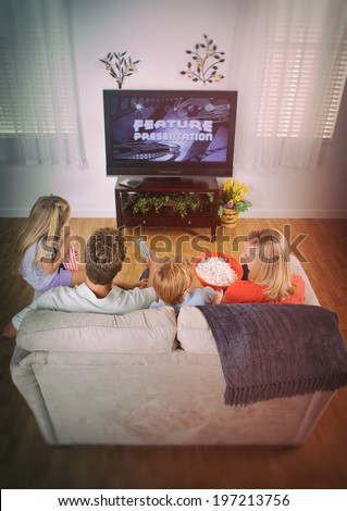 Family: Movie Night At Home With Family On Couch - stock photo